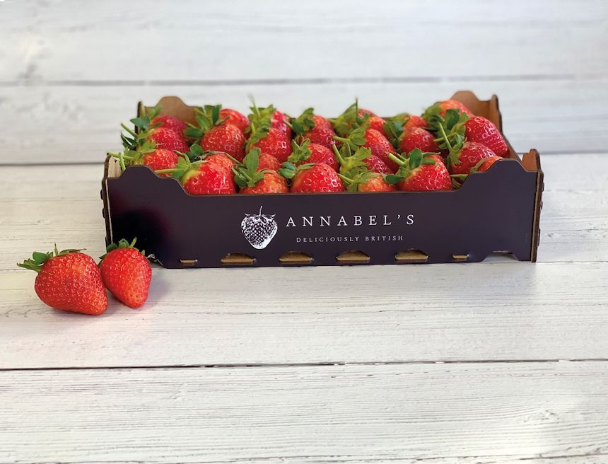 A Box of Annabel's Deliciously British Strawberries on a wooden table