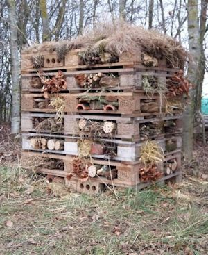 A large bug hotel in a field