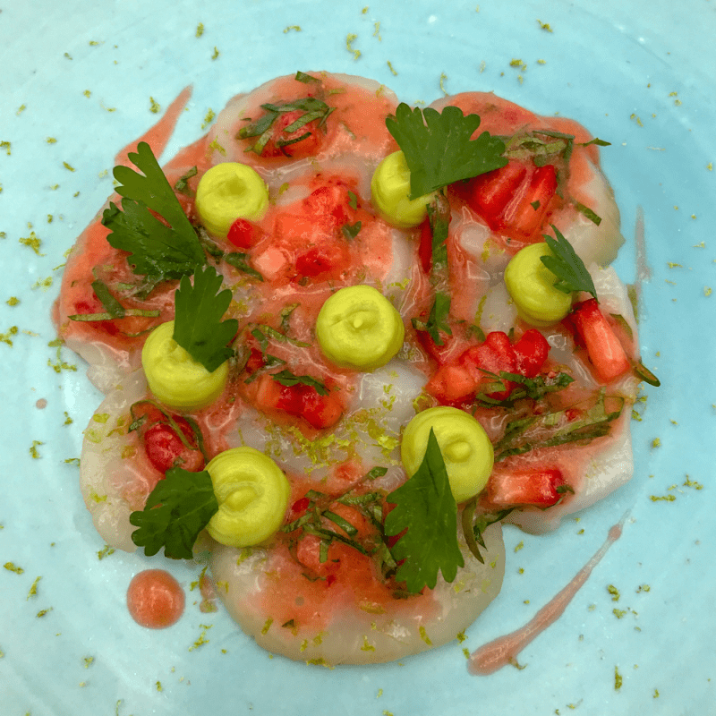 Strawberry Ceviche with basil on a plate