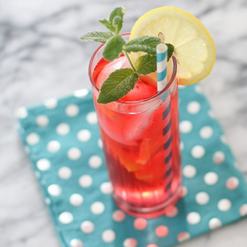 Strawberry mint crush rink, with a slice of lemon and a straw