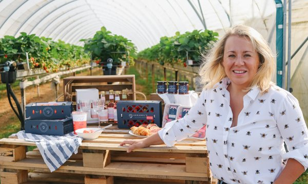 Annabel Makin-Jones in front of her strawberry farm with her strawberry products